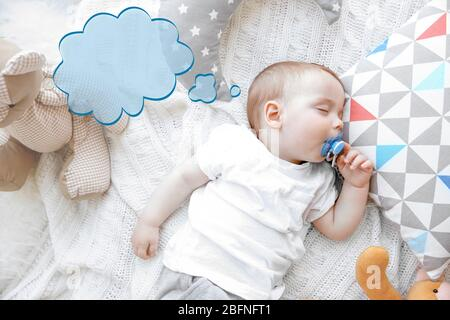 Dream cloud and cute baby sleeping on bed - Stock Photo