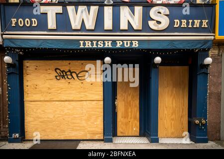 The boarded up closed Twins bar in New York on Tuesday, April 14, 2020. Due to the requirement of social distancing bars and restaurants are closing with restaurants allowed to only do take-out and delivery. (© Richard B. Levine) - Stock Photo