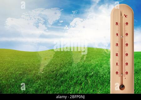 World map with thermometer showing high temperature and landscape on background. Concept of global warming and climate change. Save planet and environ
