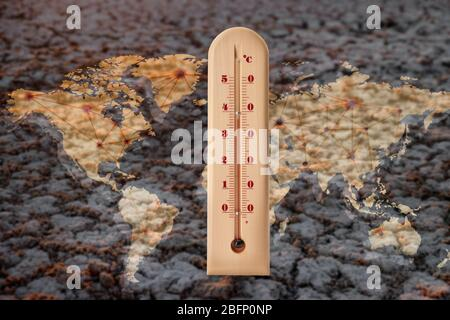 World map with thermometer showing high temperature and dry soil on background. Concept of global warming and climate change. Save planet and environm