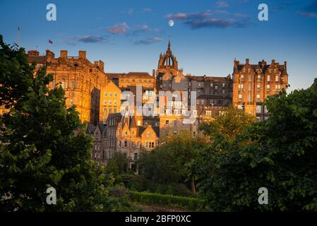 Edinburgh Old Town with St Giles' Cathedral and a rising Moon viewed from Princes Street - Stock Photo