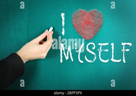 Love myself concept. Hand writing on blackboard in class room - Stock Photo