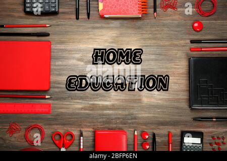 Home education concept. Frame of stationery on wooden background - Stock Photo