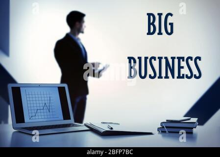 Business training concept. Businessman's workplace with laptop and documents - Stock Photo