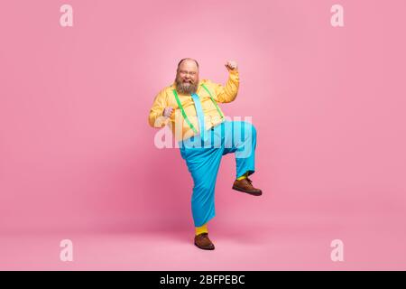 Full length body size view of his he nice funky crazy carefree positive glad bearded guy dancing having fun good mood rejoicing isolated over pink Stock Photo
