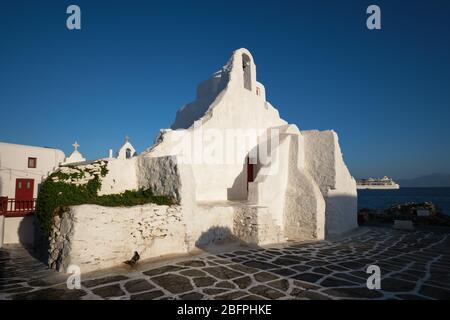 Greek Orthodox Church of Panagia Paraportiani in town of Chora on Mykonos island - Stock Photo