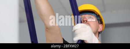 Worker climbing on ladder