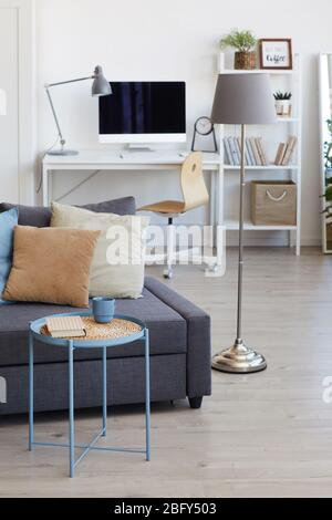 Vertical background image of cozy apartment interior in minimal Scandinavian design and focus on decor elements, copy space