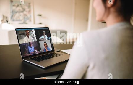 Woman  having a video conference with friends. Family meeting online over a video call. - Stock Photo