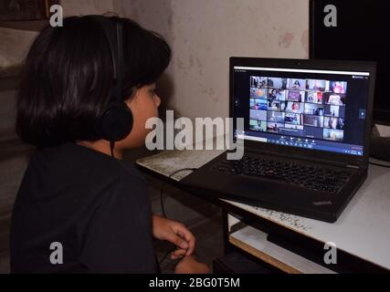 Indian student attending and watching online classes or digital classes during covid 19 or corona virus lock down. School webinar or Home Schooling - Stock Photo