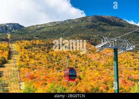 Cable car in a mountain landscape on as sunny autumn day. Stunning autumn colours.