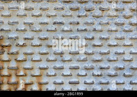Old perforated metal close-up. Rusty Sheet Metal. Abstract background. Select a focus.