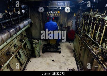 The engine room of the Bou el Mogdad antique river boat on the Senegal River. - Stock Photo