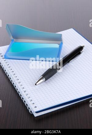 Blue business card holder, notebook and pen close-up - Stock Photo