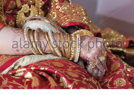 indian bride hands painted with henna close up - Stock Photo