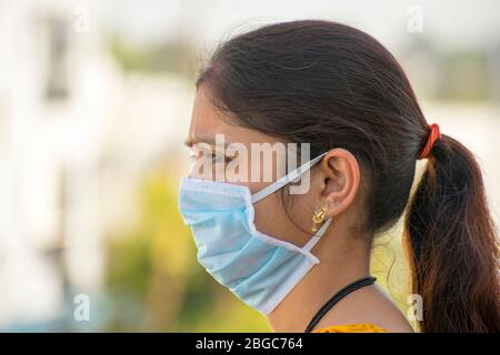 Indian woman in Disposable coronavirus mask protection against corona covid 19 virus - Stock Photo