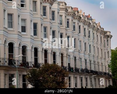 A terrace of bay fronted houses in Hove - Stock Photo