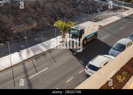 Street sweeper machine cleaning the streets during the covid 19 pandemic, Playa San Juan, Tenerife, Canary Islands, Spain - Stock Photo