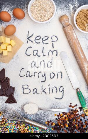 Keep calm and carry on baking written in flour with ingredients - Stock Photo