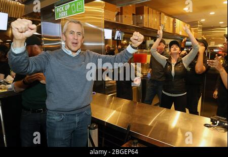 St. Louis, Missouri, USA. 21st Apr, 2020. Danny Meyer, Founder and CEO of the Burger Chain Shake Shack, leads his employees in a cheer, during the grand opening of the first St. Louis Shake Shack restaurant in this file photo in St. Louis on December 10, 2017. Shake Shack, who secured federal loans through the coronavirus stimulus law meant to help small businesses, said it will return all $10 million that it has received from the government. Meyer said he was unaware that the money would dry up so quickly and the money he received should go to restaurants that need it the most. Credit: UPI/Al Stock Photo