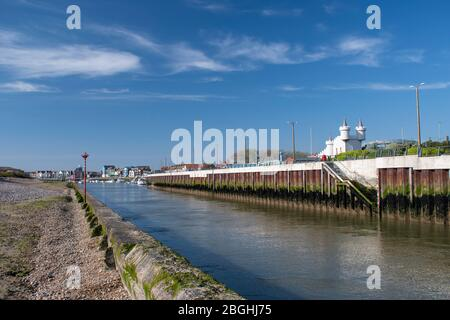 River Arun view at low tide with the boats and town in the background and the fun park situated on the east bank. - Stock Photo