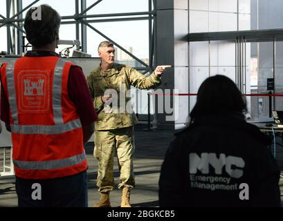 Lt. Col. Robert Stealey, of the New York Army National Guard, gives a briefing at the Jacob K. Javits Convention Center in New York, N.Y., March 24, 2020. The convention center will be an alternate care site as part of New York's multi-agency response to COVID-19. (U.S. Air National Guard photo by Senior Airman Sean Madden) - Stock Photo