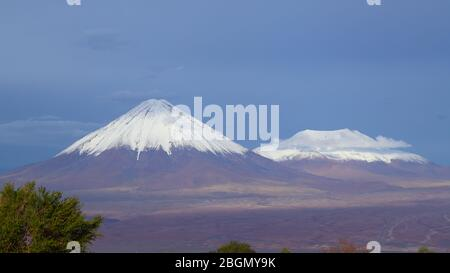 View of the Licancabur volcano covered by clouds and snow, Atacama Desert, Chile