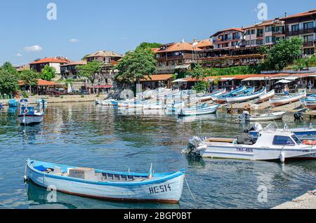 Fishing boats in the bay against the background of the old town of Nessebar, Bulgaria. - Stock Photo