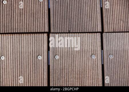 Unusual garden path made as massage road for feet. Part of that walkway made of wooden cubes. Closeup. Selective focus - Stock Photo