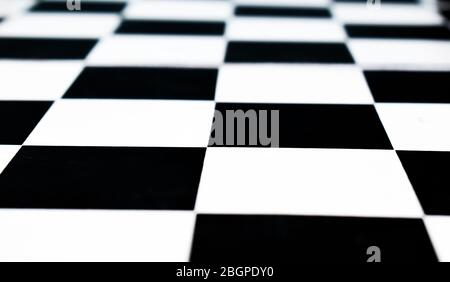 Isolated black and white colored chess board with no chess pawns placed on top of it - Stock Photo