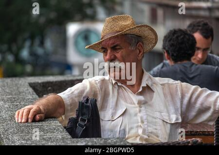 Zagreb, Croatia. 11th Aug, 2019. Local man sitting in a cafe on the main Ban Jelacic square in Zagreb - Stock Photo