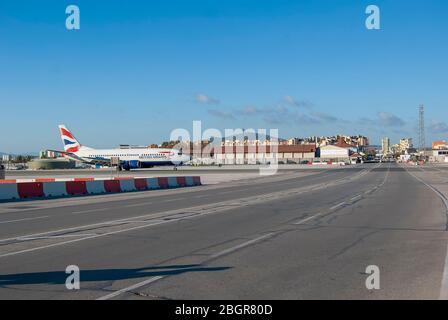 A British Airways airplane on the runway of Gibraltar International Airport - Stock Photo