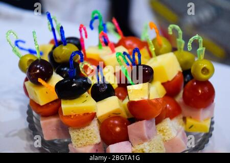 a Salad assorted, on plastic sticks vegetables and cheese. - Stock Photo