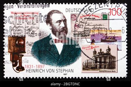 GERMANY - CIRCA 1997: a stamp printed in the Germany shows Heinrich von Stephan, General Post Director for the German Empire, circa 1997 - Stock Photo