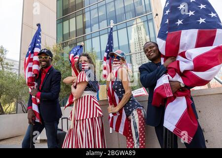 Los Angeles, USA. 22nd Apr, 2020. A small group of pro-Trump protesters call on Los Angeles City officials to re-open Los Angeles. 4/22/2020 Downtown Los Angeles, CA USA (Photo by Ted Soqui/SIPA USA) Credit: Sipa USA/Alamy Live News - Stock Photo