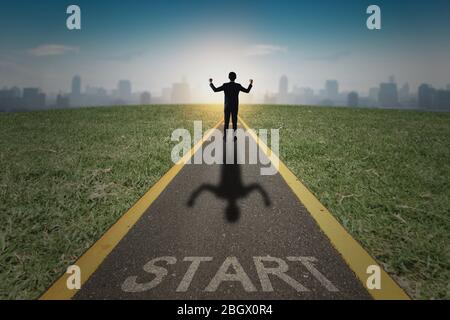 successful business way, how to success and be achievement and focus to goal concept, young businessman standing and looking out to develop working li - Stock Photo