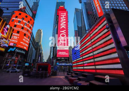 New York, New York, USA. 22nd Apr, 2020. Atmosphere in Times Square in Manhattan in New York City in the United States. Led panels pay homage to health professionals. New York City is the epicenter of the Coronavirus pandemic Credit: William Volcov/ZUMA Wire/Alamy Live News