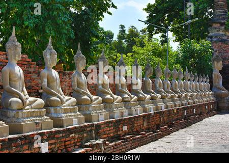 Buddha statues in  the ancient temple known as Wat Yai Chai Mongkhon, in Ayutthaya, Thailand. - Stock Photo