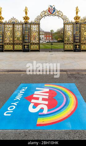 Warrington, Cheshire, UK. 23rd Apr 2020. Markings of gratitude and appreciation for the work that the NHS staff do have been painted on the road outside Warrington Town Hall and The Golden Gates in Sankey Street. The two-metre-square messages read 'NHS- Thank You' on a background of a heart and rainbow Credit: John Hopkins/Alamy Live News Credit: John Hopkins/Alamy Live News - Stock Photo