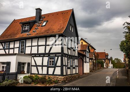 Rural historic half-timbered houses in village Trais, quarter of town Münzenberg, Wetteraukreis district, Hesse, Germany, Europe - Stock Photo