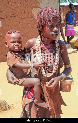 Hamer Tribeswoman holds her baby. Photographed in the Omo River Valley, Ethiopia - Stock Photo