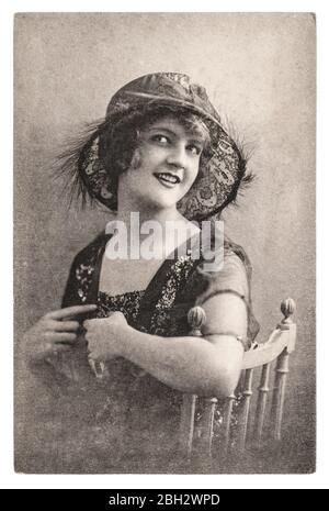 Vintage portrait of young woman in retro fashion hat - Stock Photo