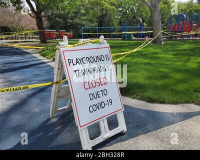 Caution tape and signs are visible at a closed playground during an outbreak of COVID-19 coronavirus in Walnut Creek, California, April 8, 2020. () - Stock Photo