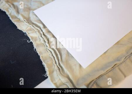 Construction of a homemade cloth face mask, based on the guidelines and sewing directions provided by the Centers for Disease Control and Prevention (CDC), during an outbreak of the COVID-19 coronavirus, San Ramon, California, April 17, 2020. () - Stock Photo