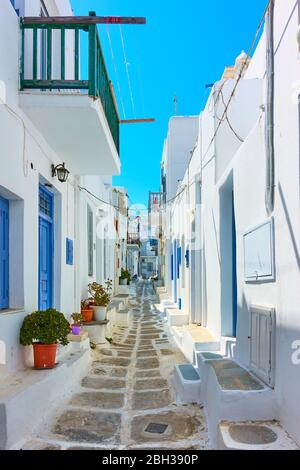 Perspective of old street with whitewashed houses in Mykonos island, Chora town, Greece - Stock Photo