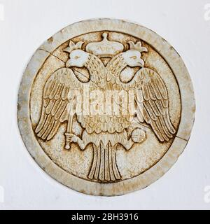 Double-headed eagle - Coat of arms of The Greek Orthodox Church - Architectural detail, Mykonos, Greece - Stock Photo