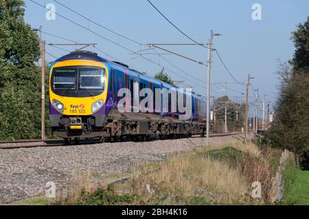 First Kelios Transpennine Express Siemens Desiro class 185 diesel train 185123 on the electrified west coast mainline in Lancashire - Stock Photo
