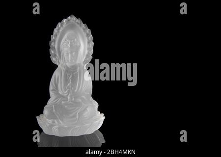 Crystal Guan yin or Quan Yin statue on black background, Chinese sculpture