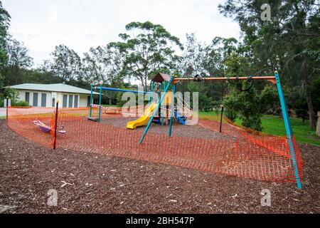 Due to COVID-19 pandemic, a public children's playground is closed and fenced off to the public. - Stock Photo