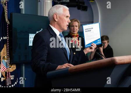 White House Coronavirus Update Briefing President Donald J. Trump listens as Vice President Mike Pence delivers remarks at a coronavirus update briefing Tuesday, March 31, 2020, in the James S. Brady Press Briefing Room of the White House.